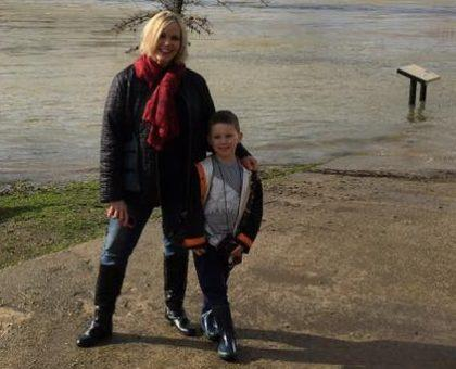 Noni Doni (in a baggy coat) and her grandson by the Sundial Bridge.