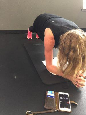 Andrea Charroin holds the record at Align Private Training in Redding with a 12-minute 15-second plank.