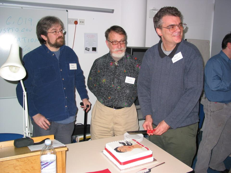 Robby Garner, Hugh Loebner, and Richard Wallace prepare to cut ALICE's birthday cake