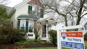 a sign in front of a house: American Home Prices Are Increasing At Double The Rate