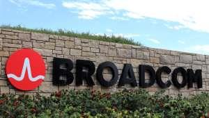 a sign in front of a brick building: Qualcomm Bid Is Take Two For Broadcom
