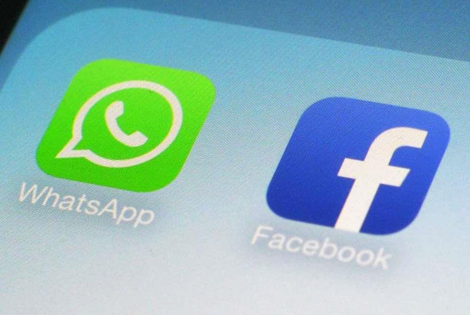 FILE - This Feb. 19, 2014, file photo, shows WhatsApp and Facebook app icons on a smartphone in New York.  Photo: Patrick Sison, STF / Copyright 2016 The Associated Press. All rights reserved. This material may not be published, broadcast, rewritten or redistribu