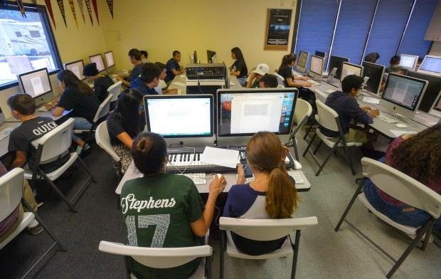 Students fill the computer lab to work on their projects at the YMCA Youth Institute in Long Beach on Friday, August 4, 2017. Many low-income children fall behind in school because they don't have internet access access at home. Students take advantage of computers and internet access at the YMCA Youth Institute to learn computer skills. (Photo by Scott Varley, Press-Telegram/SCNG)