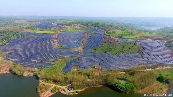 This aerial photo shows solar photovoltaic modules covering a hillside in China's eastern Anhui province