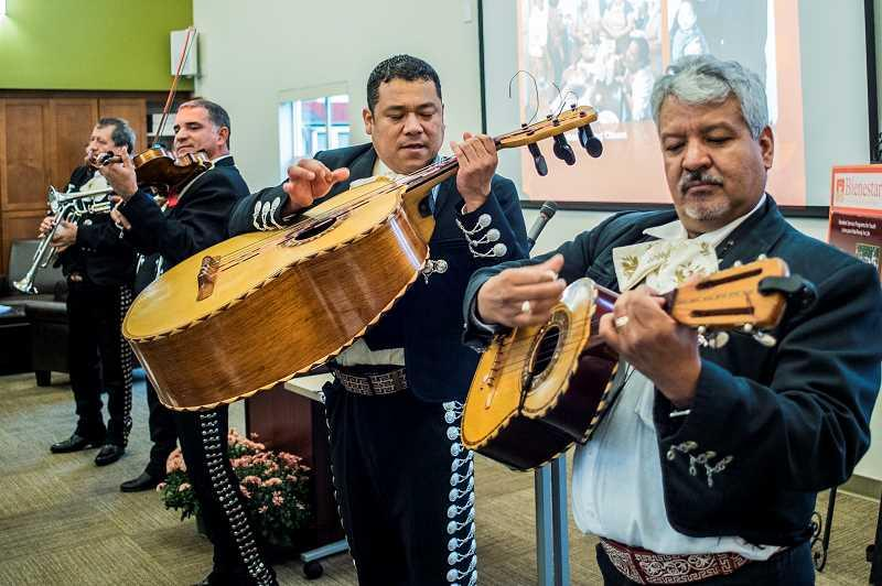 Photo Credit: NEWS-TIMES PHOTO: CHASE ALLGOOD - Members of Azteca de Oro provided spirited music for the grand opening event last Wednesday, Oct. 22.