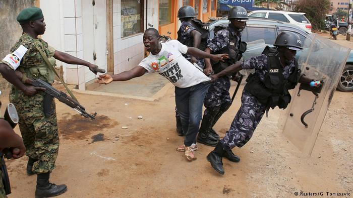 An opposition supporter being arrested