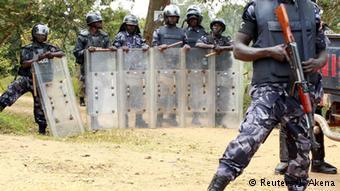 Riot police © Reuters/J. Akena