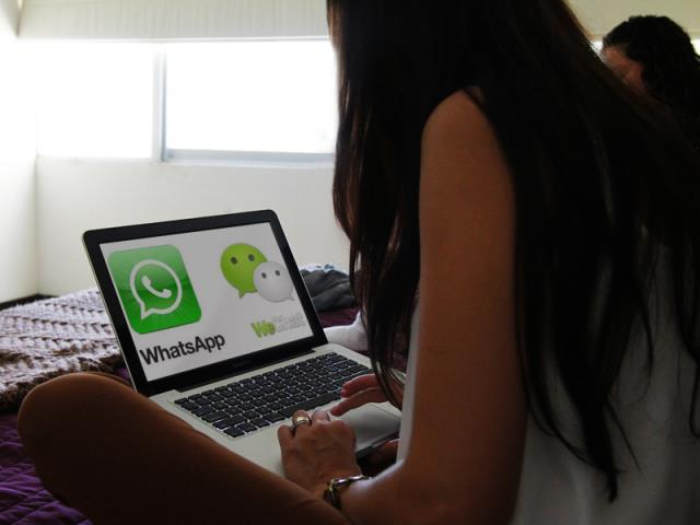 WhatsApp or WeChat on Laptop