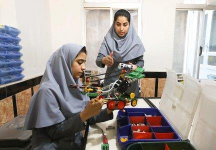 Members of Afghan robotics girls team which was denied entry into the United States for a competition, work on their robots in Herat province, Afghanistan July 4, 2017. REUTERS/Mohammad Shoib